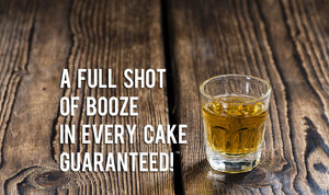 Booze in Every Cake Guaranteed photo shot glass alcohol wood table