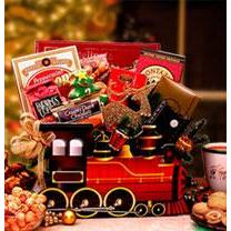 Purchase this Christmas Holiday Express Train Gift Box that fits inside a train gift box that is filled to the brim with decadent goodies like caramel covered wafer cookies, chocolate truffles, shortbread cookies and more. When you give this gift basket today it will be remembered forever.