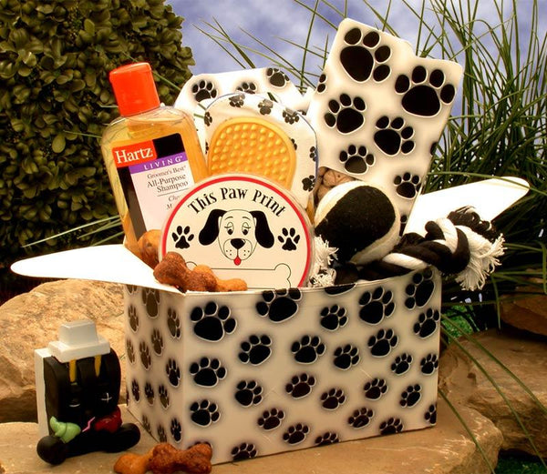 Buy this Paw Prints Dog Gift Box, what a fantastic way to spoil the dog in your life or their owner's with a fun and imaginative pet care package designed specifically for the dog lover. An adorable dog paw print gift box comes loaded with toys and treats.