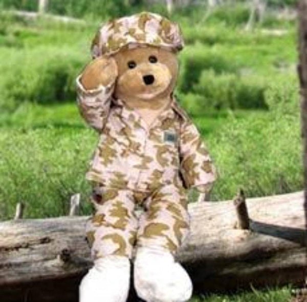 "Send your Hero our American Gi Hero Singing Bear to show him how much you really care. 22"" High and all dressed out in his cammo outfit. His mouth moves and he sways too and forth as he sings ""God Bless the USA"" !"