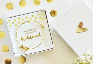 Purchase these Gold Monogram Bridal Party Bracelets that make glamorous gifts for your bridesmaids and maid-of-honor. 18k plated gold bracelets. A gift Box can be added.