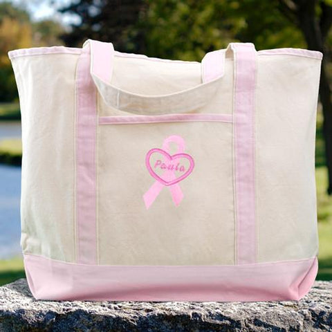 "Buy this Personalized Breast Cancer Awareness Pink Canvas Tote Bag that is made of 100% cotton.  Canvas Tote Bag with front pocket measuring 21 -1/2"" x 16"" x 7"".  This personalized tote bag is made especially strong to hold all your take along items.""  Most Orders ship in 2-3 Days."