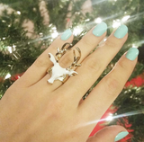 White And Gold Deer Head Ring Beside Christmas Tree