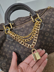 Gold chain bag charm with lock for speedy bag