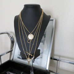 4 tier layering necklace in gold