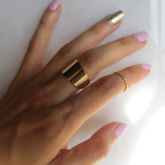 gold wide band and midi ring
