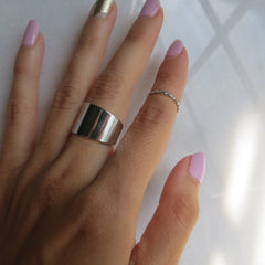 silver wide band and thin midi ring