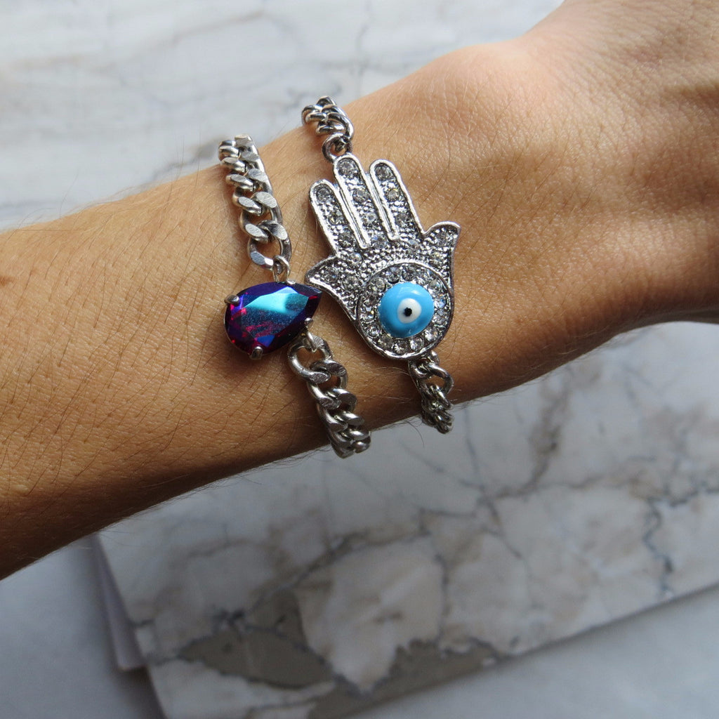 silver hamsa bracelet with blue evil eye and rhinestones