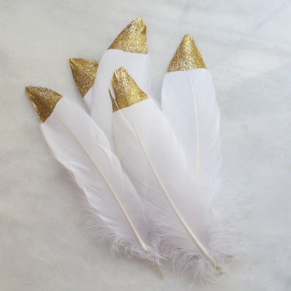 gold tipped white feathers