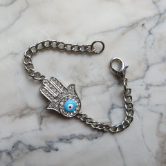 hamsa with rhinestones and evil eye