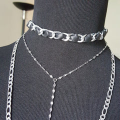layered chain and leather choker necklaces