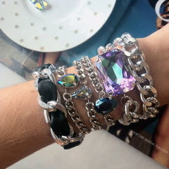 stacked crystal and leather bracelets