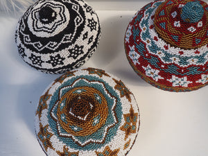 BEADED STORAGE BASKETS AND TRINKETS.