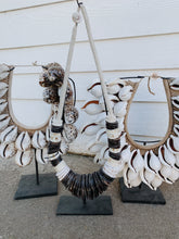 Load image into Gallery viewer, BLACK AND WHITE TRIBAL PEACE NECKLACE ON STAND