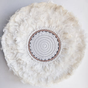 white feather juju with crochet centre, beige highlights and  shells, flat wall hanging
