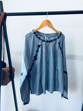 Load image into Gallery viewer, Light Wash Blue Linen Shirt With Black Floral Hand Embroidered Detail.
