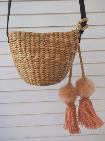 Woven Straw Girls Bag - Musk Blush Pom Pom Hanging Detail