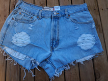 Load image into Gallery viewer, Vintage distressed Levis cut off shorts, loose fit for women