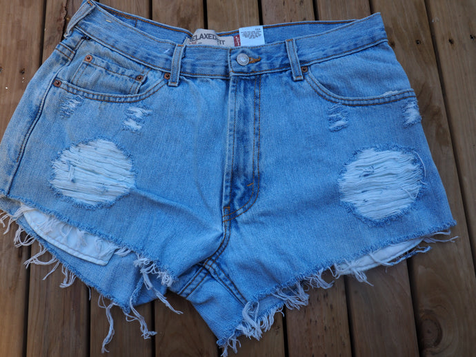 Vintage distressed Levis cut off shorts, loose fit for women