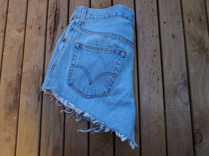 MY VINTAGE-AUTHENTIC LEVIS BOYFRIEND CUT OFF DISTRESSED DENIM SHORTS.