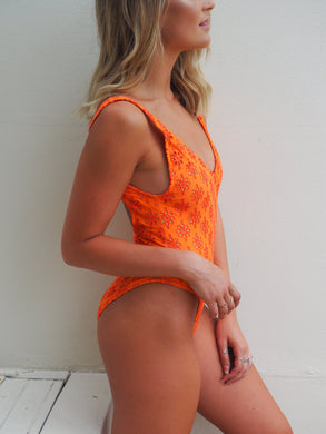 BOND ICONIC ONE PIECE / Anglaise lycra in orange, high cut leg and deep scoop back and front swimsuit.GERRY CAN