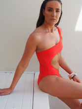 Load image into Gallery viewer, the Kara is a one shoulder one piece with cut away at the torso, high cut leg. Sommersalt red