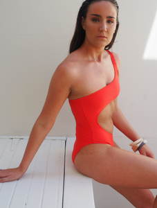 the Kara is a one shoulder one piece with cut away at the torso, high cut leg. Sommersalt red