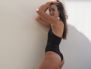 The Avalon is a high cut one piece in black seamless and reversible with one shoulder strap by GERRY CAN