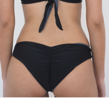 Load image into Gallery viewer, The Brooklyn is a Brazilian style scrunch bikini bottom,seamless and Reversible Black and Charcoal Grey . by Gerry Can