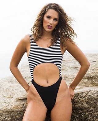 black one piece with cut out tummy and black and white stripe front by gerry can