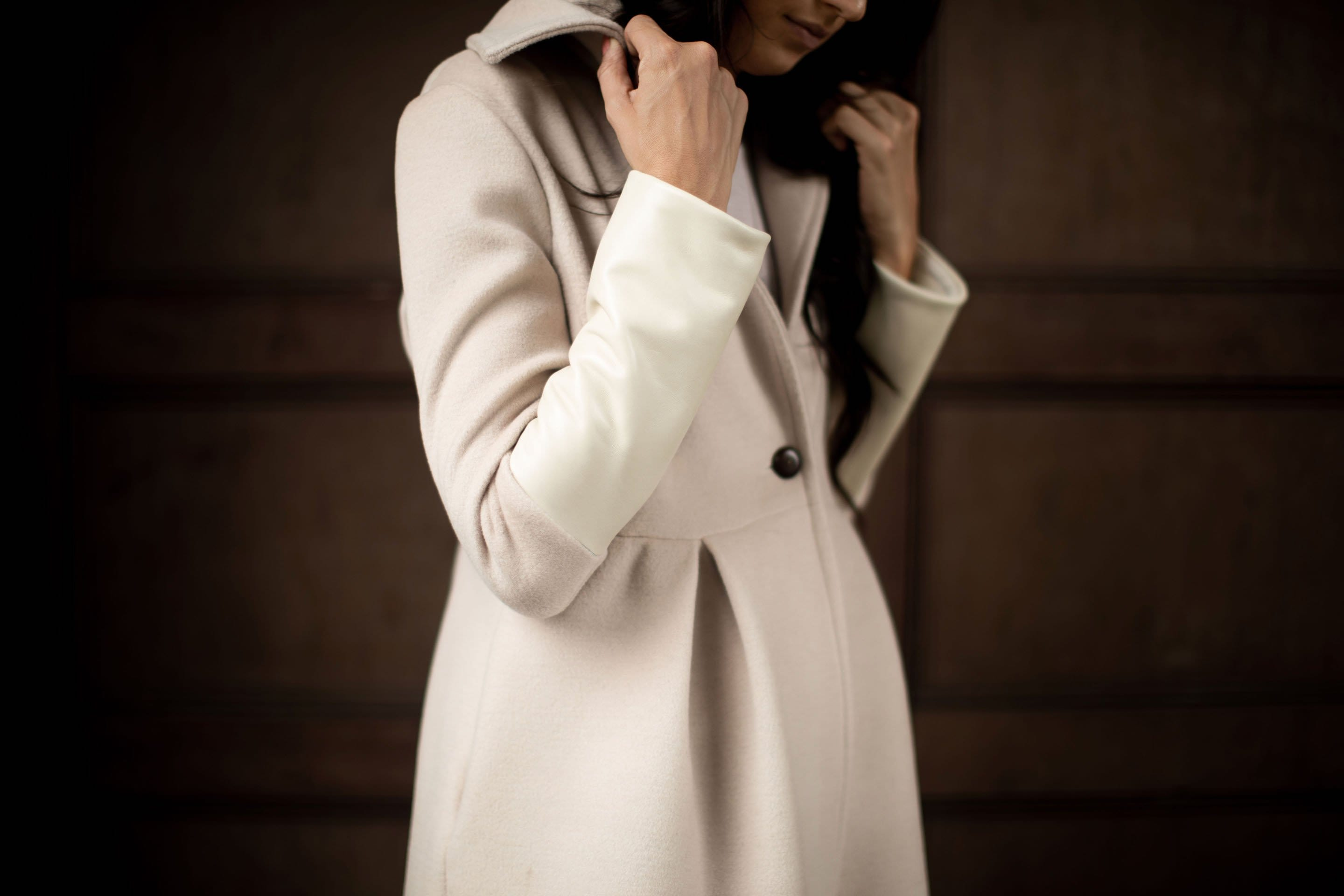 white leather wool coat