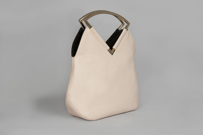 Reversible black and nude hand bag by Versa Versa