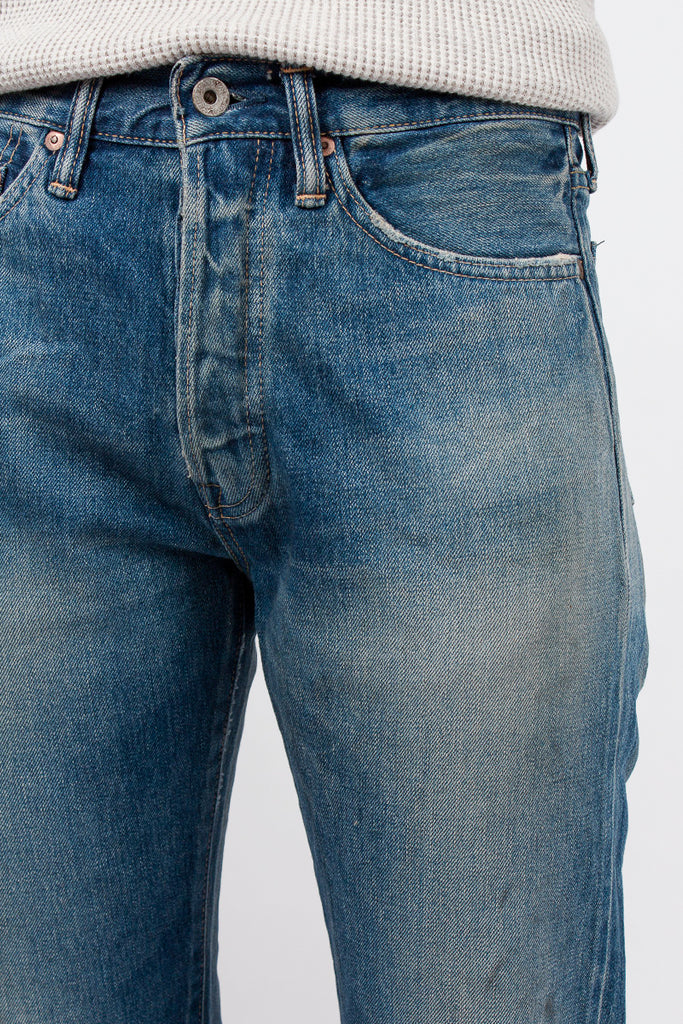 Medium Distress Tapered Jean