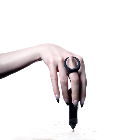 https://therogueandthewolf.com/products/eclipse-ring-in-black
