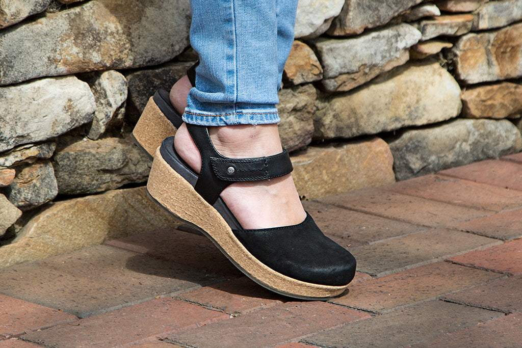 Go from spring to summer in comfort and style with OTBT's Elizabeth closed-toe wedge sandals.