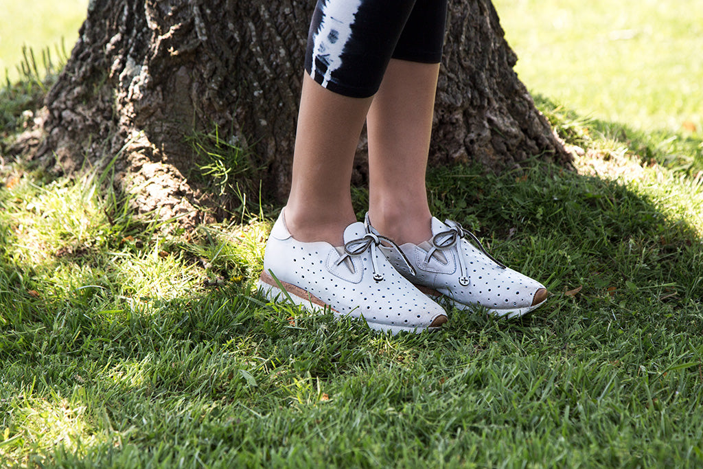 OTBT's Lunar sneakers paired with an athleisure outfit.
