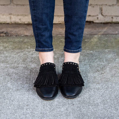 Womens slide loafers gleam in black close up