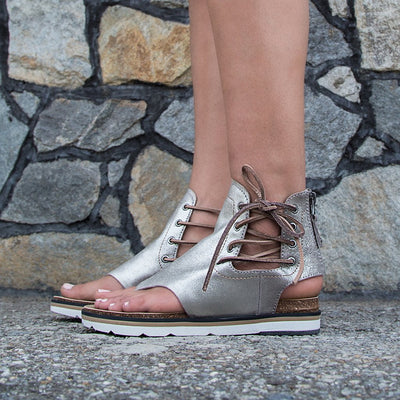 womens flat sandals locate in grey silver close up