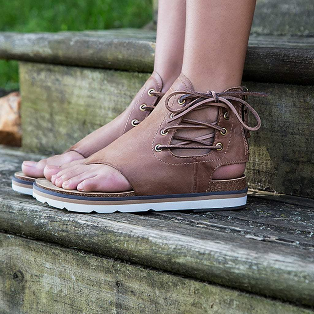 0af01f94d11 Womens flat sandal locate in new brown close up