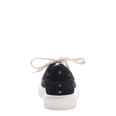 Normcore women's sneaker in black back view