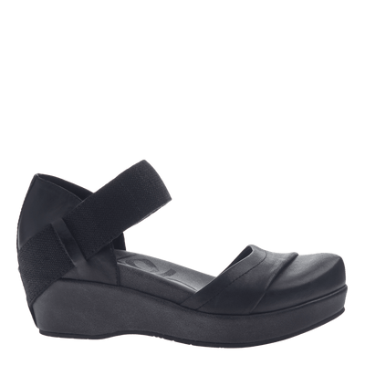 Womens closed toe wedges wander out in black side view