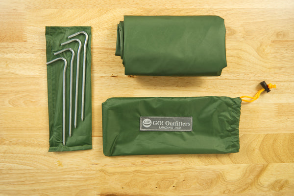 The Landing Pad includes four stakes and a water resistant stuff sack. It's perfect for your next hammock camping or tent camping trip!
