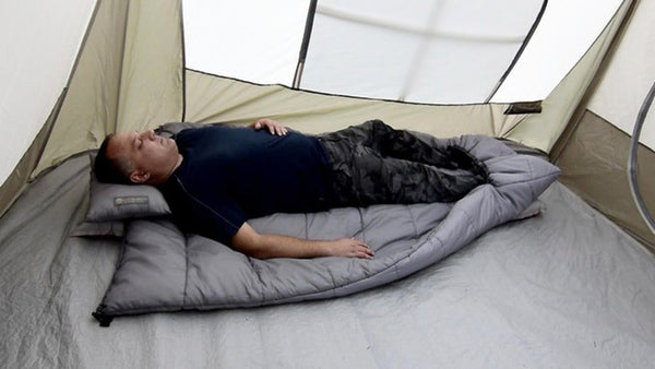 In warmer weather, you can sleep on top of the Adventure Top Quilt for extra cushioning