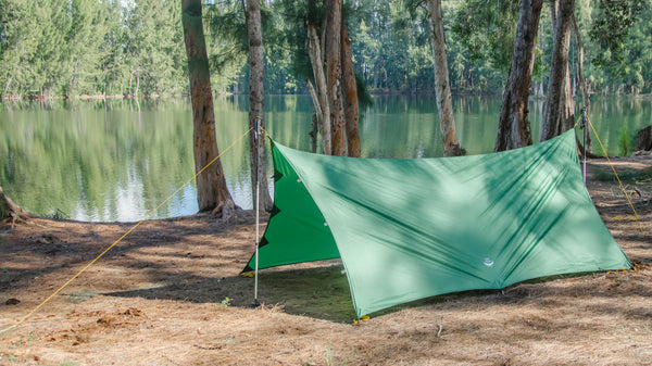 2 Pole Tarp Camping Mode of Apex Tarp using found sticks or your hiking poles, the Apex can be pitched as a camping tarp with excellent coverage.