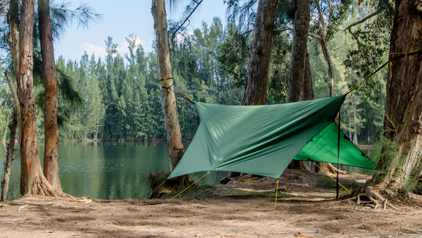 Photo of the Apex Camping Shelter Hammock Camping Tarp by Go Outfitters set up in storm mode