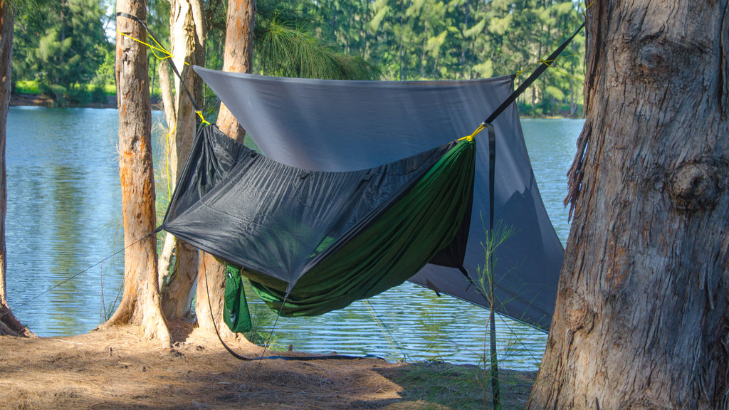 Convertible Mode of Apex Campuing Shelter by Go Outfitters. One side of this hammock camping tarp easily flips out of the way.