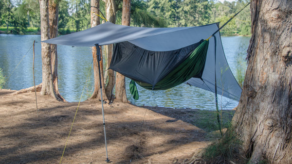 Porch Mode: Use you own hiking poles or sticks to raise one or both sides of the tarp. This mode is open and airy and creates a large living space with a great view of the outdoors while hammock camping!