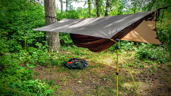 Go Outfiiter Landing Pad protecting gear under the Apex Campign Shelter Hammock Tarp and the GO! Camping Hammock 2.0