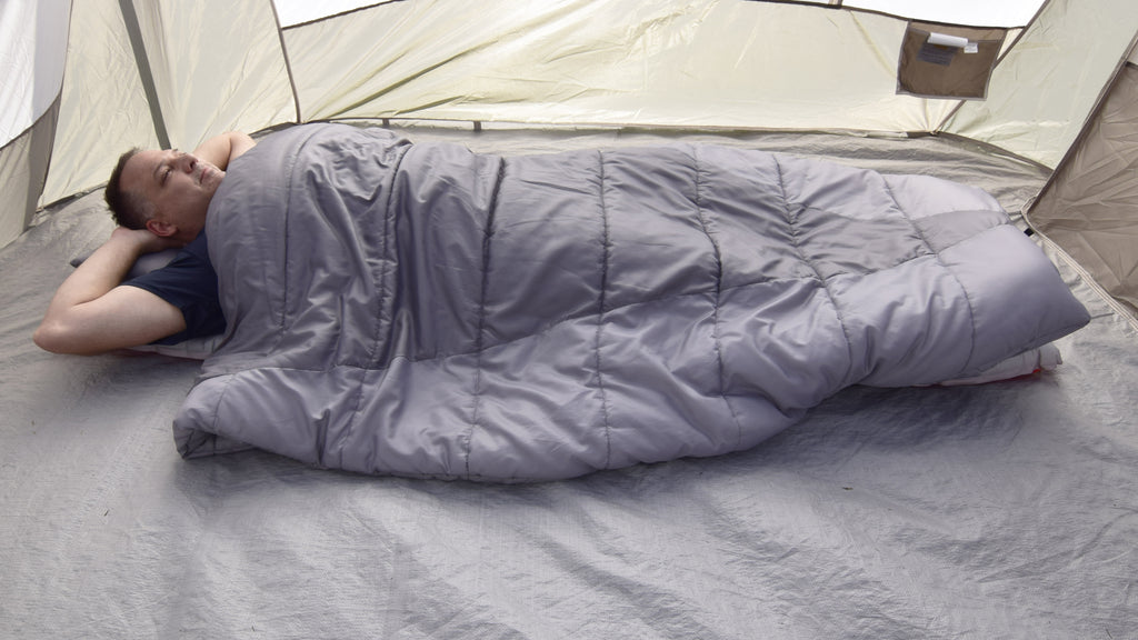 Adventure Top Quilt being used as a Sleeping Bag In a camping tent (photo)