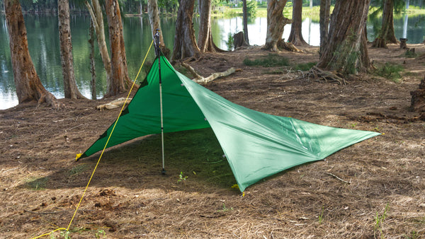 Single Pole Tarp Campign Mode provides excellent weather protection witht he waterproof Apex Camping Shelter